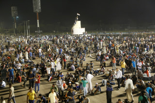 Image: Followers of Iraq's Shi'ite cleric Moqtada al-Sadr hold a sit-in at Grand Festivities Square in Baghdad