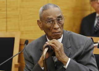Image: Paul Gatling listens during a court session