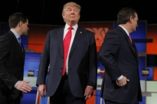 Republican U.S. presidential candidate Trump stands between rivals Rubio and Cruz before the start of the Fox Business Network Republican presidential candidates debate in North Charleston