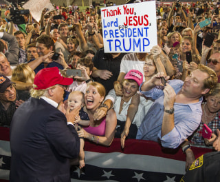 Image: Trump greets supporters after his rally at Ladd-Peebles Stadium
