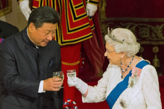 Image: File photo of Chinese President Xi Jinping with Queen Elizabeth II at a state banquet at Buckingham Palace in London