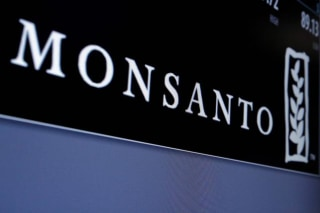 Monsanto is displayed on a screen where the stock is traded on the floor of the NYSE