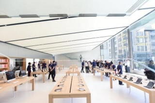 Workers staff a new Apple retail store during a media preview in San Francisco