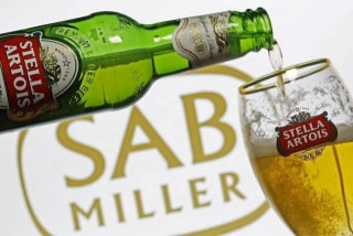 Photo illustration of beer flowing from a bottle of Stella Artois into a glass