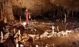 Image: A scientist takes measurements for the archaeo-magnetic survey in the Bruniquel Cave in southwestern France in this undated handout photo