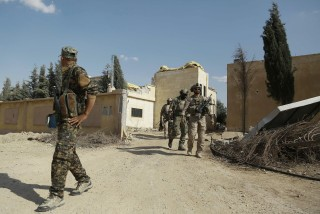 Image: US special forces walk through Fatisah