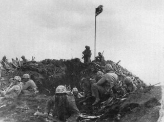 The first flag raised by U.S. troops on Iwo Jima's Mount Suribachi in this photo taken by Marine Sgt. Louis Burmeister.