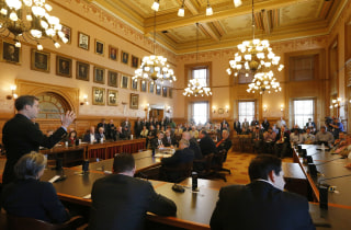Kansas Gov. Sam Brownback addresses members of state legislature