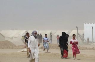 Image: TOPSHOT-IRAQ-CONFLICT-FALLUJAH-DISPLACED