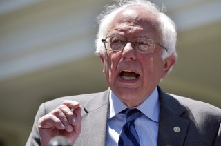 Image: Democratic presidential candidate Bernie Sanders speaks to the press