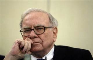 U.S. Investor Warren Buffett listens to a question during a news conference in Madrid