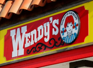 A Wendy's sign and logo are shown at one of the company's restaurant in Encinitas, California