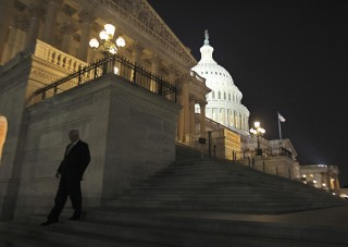 Image: A member of the U.S. House of Representatives walks down the steps from the House Chamber as he exits the U.S. Capitol in Washington