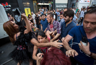 Image: LGBT rights activists struggle with plainclothes police officers before a Gay Pride Parade in central Istanbul