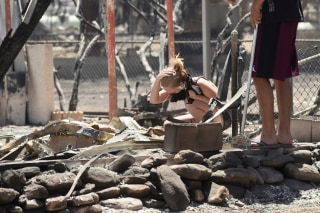Image: Brittany Thompson cries after finding a deceased dog at a burned down residence after the Erskine Fire burned through South Lake, California