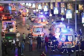 Image: Paramedics help casualties outside Turkey's largest airport, Istanbul Ataturk, Turkey, following a blast