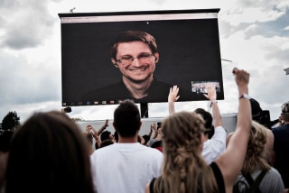 Image: American whistleblower Edward Snowden is seen on a screen as he delivers a speech during the Roskilde Festival in Roskilde