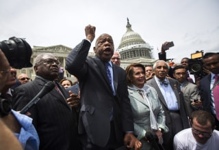 Image: Democratic Representative from Georgia John Lewis (C) speaks to supporters after Democratic House members held a sit-in