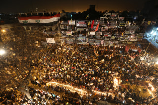Image: People gather to pray at the scene of a massive truck bomb attack in Baghdad