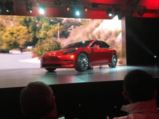 A Tesla Model 3 sedan, its first car aimed at the mass market, is displayed during its launch in Hawthorne, California