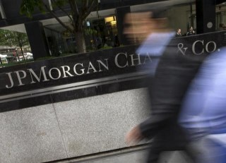 People pass the JP Morgan Chase & Co. Corporate headquarters in the Manhattan borough of New York