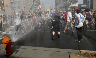 Image: Supporters of Sen. Bernie Sanders cool off at a fire hydrant