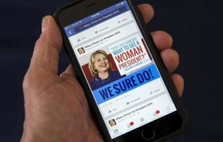 A mobile phone shows a Facebook page promoting Hillary Clinton for president in 2016, in this photo illustration