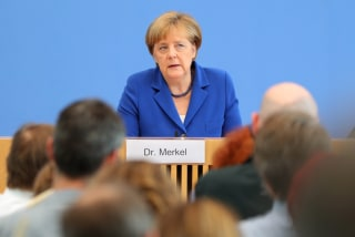 Image: German Chancellor Angela Merkel press conference