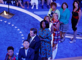 Congressional candidates that are running for office watch a video while standing onstage at the Democratic National Convention in Philadelphia, Pennsylvania
