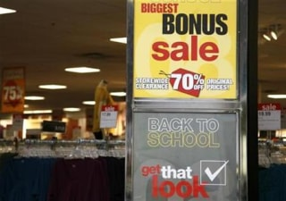 "Signs announce a sale for ""back to school"" at a JC Penney Co store in Westminster"