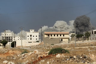 Image: Smoke rises after an airstrike on the rebel held al-Rashideen neighbourhood, Western Aleppo province
