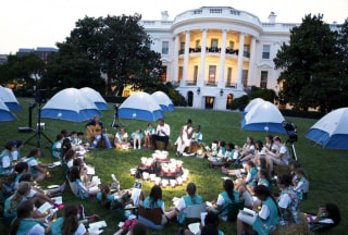 Obama and first lady join Girl Scouts for singalong during camp-out on South Lawn of White House in Washington