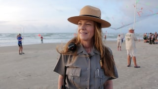 Image: Dr. Donna Shaver and the turtle recovery program release Kemp's Ridley turtle hatchlings into the Gulf of Mexico