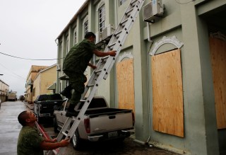 Image: Soldiers cover the windows of Belize City's town hall, as Hurricane Earl approaches,in Beilize City