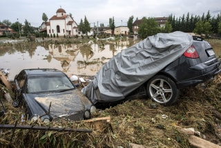 Image: At least 15 people have died in heavy rain storm that hit Skopje