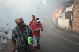 Image: Residents walk on the streets Bom Sucesso