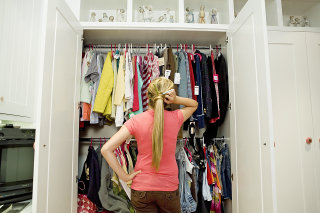 Teenage girl looking in closet