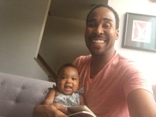 David Johns reads to niece