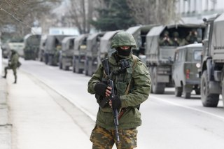 Image: Soldiers wait in Russian army vehicle