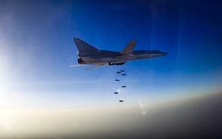 Image: An image provided by Russia's defense ministry shows a Russian Tu-22M3 over Aleppo, Syria