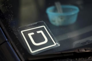 An Uber car is seen parked with the driver's lunch left on the dashboard in Venice, Los Angeles