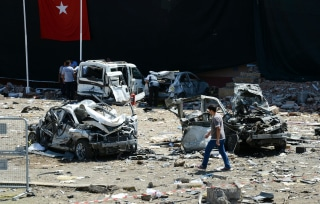 Image: Turkish rescue workers amid the wreckage of a bomb attack on a police station in Elazig, Thursday.