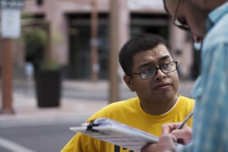 Image: Jose Barboza, a Promise Arizona volunteer, registers voters in Phoenix