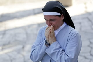 Sister Marjana Lleshi gets emotional during an interview with the Associated Press in Ascoli Piceno, Italy, Aug. 25.