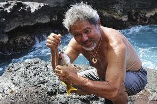 Image: G. Umi Kai uses a traditional Hawaiian hook to catch a fish