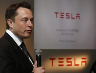 Tesla Motors Inc Chief Executive Musk speaks during a news conference in Tokyo