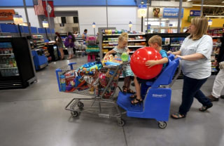 A family shops at the Wal-Mart Supercenter in Springdale