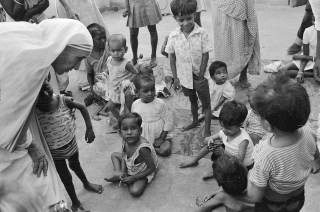 Image: Mother Teresa talks with and blesses orphans in 1979