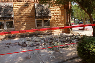 Image: Stonework litters the sidewalk outside an empty jewelry store at the corner of Sixth and Harrison in Pawnee