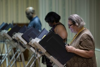 Image: Voters cast electronic ballots during primary voting in Stark County